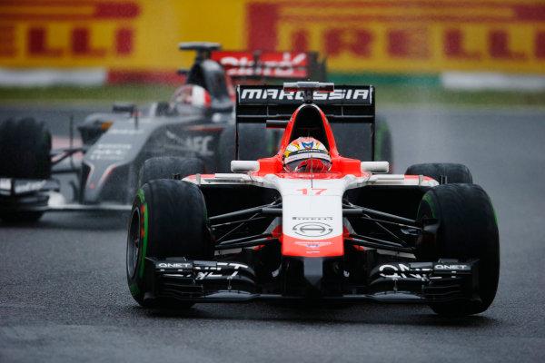 Suzuka Circuit, Suzuka, Japan.  Sunday 5 October 2014. Jules Bianchi, Marussia MR03 Ferrari, leads Adrian Sutil, Sauber C33 Ferrari. World Copyright: Steven Tee/LAT Photographic. ref: Digital Image _L4R3022