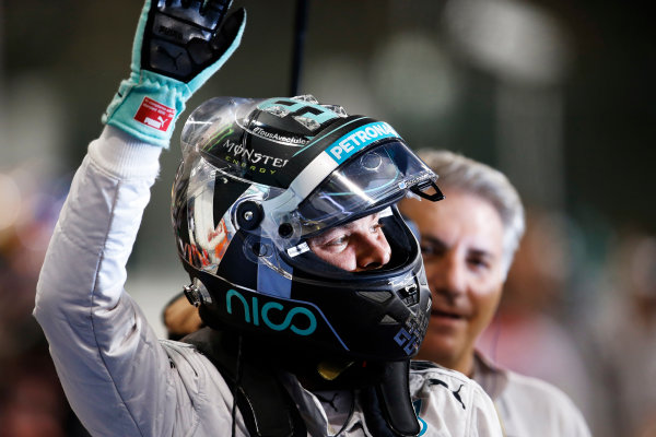Yas Marina Circuit, Abu Dhabi, United Arab Emirates. Saturday 22 November 2014. Nico Rosberg, Mercedes AMG, celebrates pole in Parc Ferme. World Copyright: Steven Tee/LAT Photographic. ref: Digital Image _X0W0040