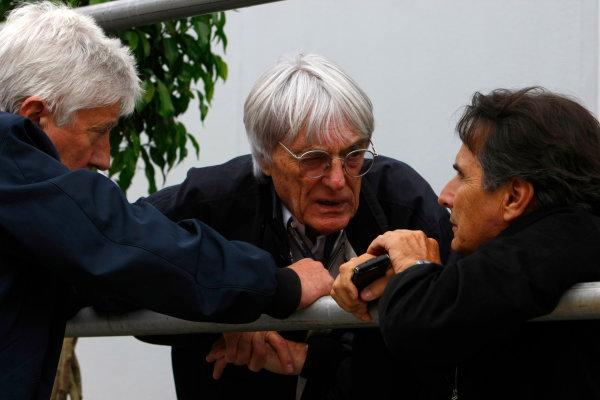 Interlagos, Sao Paulo, Brazil.16th October 2009.Bernie Ecclestone with Herbie Blash, FIA, and Nelson Piquet. Portrait. World Copyright: Charles Coates/LAT Photographicref: Digital Image _26Y9428