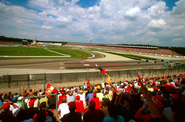 Hockenheim, Germany.25-27 July 1997.The home fans cheer for their hero Michael Schumacher (Ferrari F310B) at the Elfkurve on the way to 2nd position.Ref-97 GER 18.World Copyright - LAT Photographic