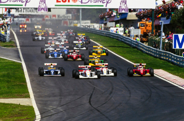 Mika Häkkinen, McLaren MP4/8 Ford leads at the start from Ayrton Senna, McLaren MP4/8 Ford, Alain Prost, Williams FW15C Renault and Jean Alesi, Ferrari F93A.