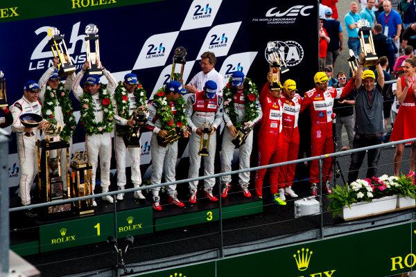 2016 Le Mans 24 Hours. Circuit de la Sarthe, Le Mans, France. Sunday 19 June 2016. Porsche Team / Porsche 919 Hybrid - Romain Dumas (FRA), Neel Jani (CHE), Marc Lieb (DEU), Toyota Gazoo Racing / Toyota TS050 - Hybrid - Stephane Sarrazin (FRA), Michael Conway (GBR), Kamui Kobayashi (JPN), Audi Sport Team Joest / Audi R18 - Lucas Di Grassi (BRA), Loic Duval (FRA), Oliver Jarvis (GBR), Rebellion Racing / Rebellion R-One-AER - Nicolas Prost (FRA), Nick Heidfeld (DEU), Nelson Piquet (NLD).  World Copyright: Zak Mauger/LAT Photographic ref: Digital Image _79P9229
