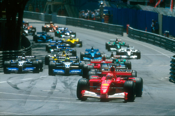 Monte Carlo, Monaco. 29th May 2001. Michael Schumacher, Ferrari F2001, makes the best start from the grid into Ste Devote.World Copyright: Clive Rose/LAT Photographic ref: 35mm Priority Image 01MON03
