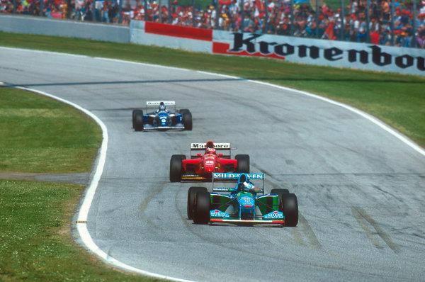 Imola, Italy.29/4-1/5 1994.Michael Schumacher (Benetton B194 Ford) leads Gerhard Berger (Ferrari 412T1) and Damon Hill (Williams FW16 Renault).Ref-94 SM 15.World Copyright - LAT Photographic