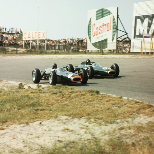 Zandvoort, Holland. 22-24 May 1964. Graham Hill (number 6, BRM P261) and Dan Gurney (Brabham BT7 Climax). Hill finished in 4th position. Ref-3/1227. World Copyright - LAT Photographic