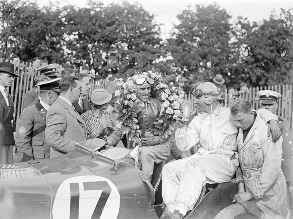 Tazio Nuvolari, 1st position, sits in his MG Magnette K3 with his riding mechanic Alec Hounslow after the race.