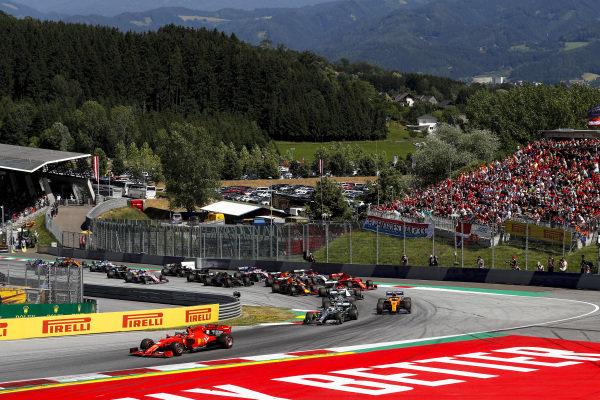 Charles Leclerc, Ferrari SF90 leads Valtteri Bottas, Mercedes AMG W10, Lewis Hamilton, Mercedes AMG F1 W10 and Lando Norris, McLaren MCL34 at the start of the race