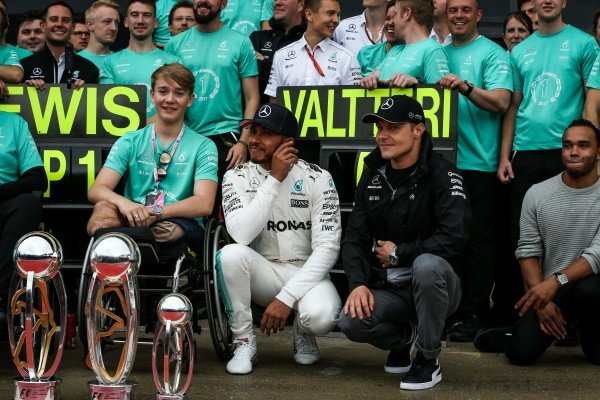 Race winner Lewis Hamilton (GBR) Mercedes AMG F1 celebrates with the trophies alongside his brother Nick Hamilton (GBR), Valtteri Bottas (FIN) Mercedes AMG F1, Billy Monger (GBR) and the team at Formula One World Championship, Rd10, British Grand Prix, Race, Silverstone, England, Sunday 16 July 2017.