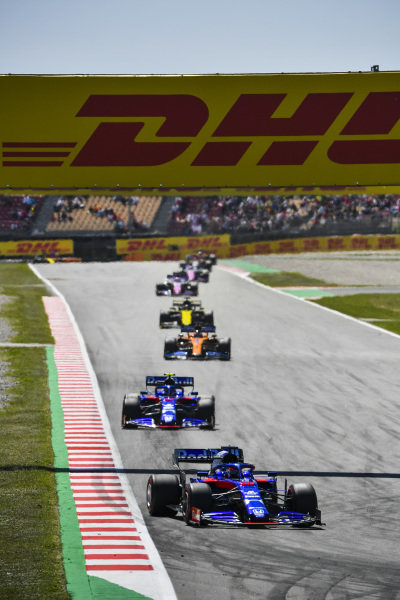 Daniil Kvyat, Toro Rosso STR14, leads Alexander Albon, Toro Rosso STR14, and Carlos Sainz Jr., McLaren MCL34