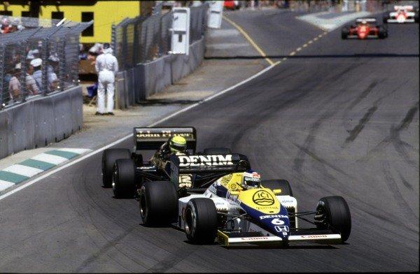 1985 Australian Grand Prix.Adelaide, Australia.1-3 November 1985.Keke Rosberg (Williams FW10 Honda) leads Ayrton Senna (Lotus 97T Renault). Rosberg finished in 1st position.World Copyright - LAT Photographic