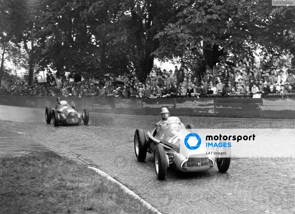 1951 Swiss Grand Prix, Bremgarten, Switzerland. 1951.Race winner (1st), Juan Manuel Fangio, (Alfa Romeo 159A 8), action.World Copyright: LAT Photographic. ref: Autocar Glass Plate C29190