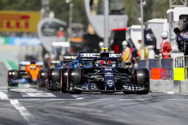 Pierre Gasly, AlphaTauri AT02, leads Fernando Alonso, Alpine A521