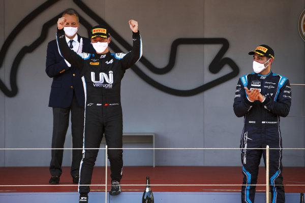 Race Winner Guanyu Zhou (CHN, Uni-Virtuosi Racing) and Roy Nissany (ISR, DAMS) celebrate on the podium