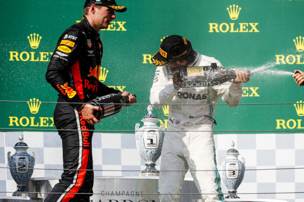 Max Verstappen, Red Bull Racing, 2nd position, and Lewis Hamilton, Mercedes AMG F1, 1st position, spray Champagne