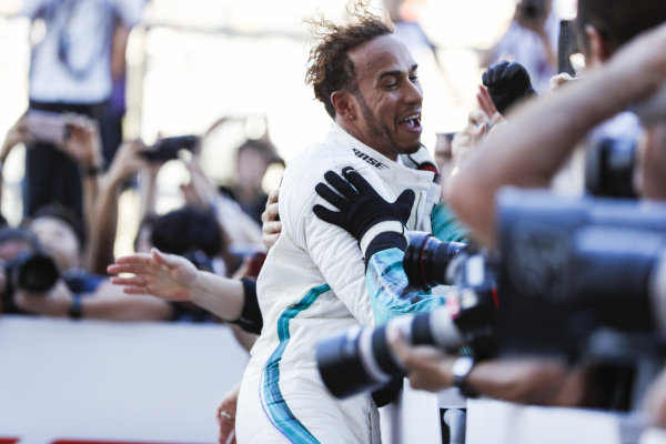 Lewis Hamilton, Mercedes AMG F1, 1st position, celebrates winning with his team.