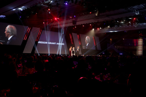 Sir Jackie Stewart presents the Gregor Grant award to the Monaco Grand Prix