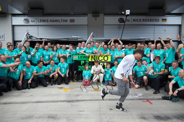 Red Bull Ring, Spielberg, Austria. Sunday 21 June 2015. Nico Rosberg, Mercedes AMG, 1st Position, and Lewis Hamilton, Mercedes AMG, 2nd Position, celebrate with the Mercedes AMG team. World Copyright: Steve Etherington/LAT Photographic. ref: Digital Image SNE14901