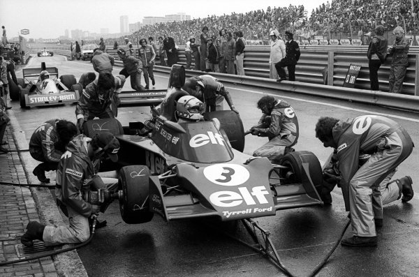 Jody Scheckter (RSA) Tyrrell 007 makes a pit stop to change to slick tyres in the drying conditions. He finished sixteenth and last after stopping with an engine problem.Dutch Grand Prix, Rd 8, Zandvoort, Holland, 22 June 1975.