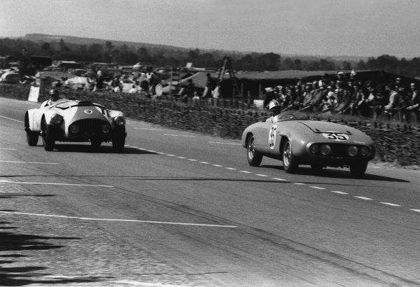 Le Mans, France. 13th - 14th June 1953 Maurice Trintignant/Harry Schell (Gordini T24S), 6th position, passes Leslie Johnson/Bert Hadley (Nash-Healey Sports), 11th position, action. World Copyright: LAT Photographic Ref: 53 - 52 - 17A-18.