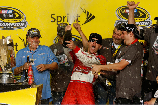 14-16 November, 2014, Homestead, Florida USA Champion Kevin Harvick and team in victory lane with champagne ©2014, Michael L. Levitt LAT Photo USA