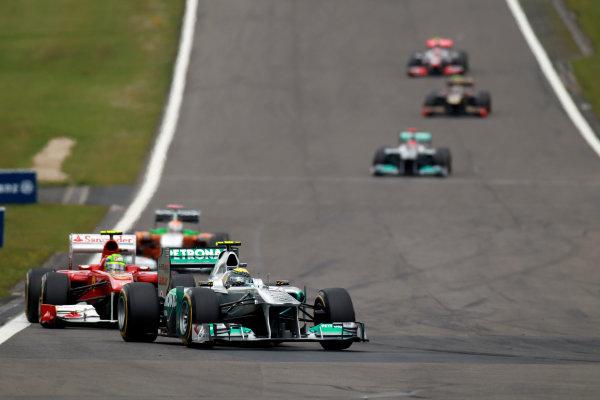 Nurburgring, Germany24th July 2011Nico Rosberg, Mercedes GP W02, 7th position, leads Felipe Massa, Ferrari 150° Italia, 5th position. Action. World Copyright:Glenn Dunbar/LAT Photographicref: Digital Image C27C4400