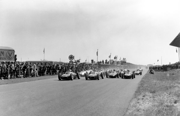 1961 Dutch Grand Prix. Zandvoort, Holland. 22 May 1961. Phil Hill, Wolfgang von Trips and Richie Ginther (all Ferrari Dino 156) lead at the start. World Copyright: LAT Photographic Ref: Autocar Glass Plate C61703