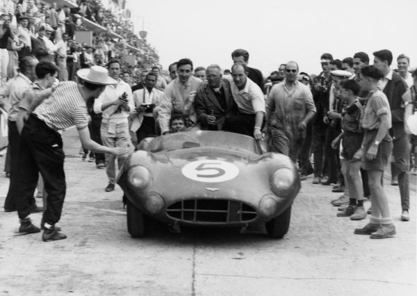 1959 Le Mans 24 hours.Le Mans, France. 20-21 June 1959.Roy Salvadori/Carroll Shelby (Aston Martin DBR1), 1st position,  Stirling Moss puts his arm around Team Owner and Chief Designer, David Brown, as they drive into parc ferme, action.World Copyright: LAT PhotographicRef: C55984