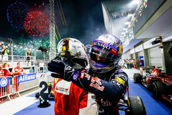 Marina Bay Circuit, Singapore. Sunday 20 September 2015. Sebastian Vettel, Ferrari, 1st Position, and Daniel Ricciardo, Red Bull Racing, 2nd Position, celebrate in Parc Ferme.  World Copyright: Steven Tee/LAT Photographic. ref: Digital Image _L4R1886