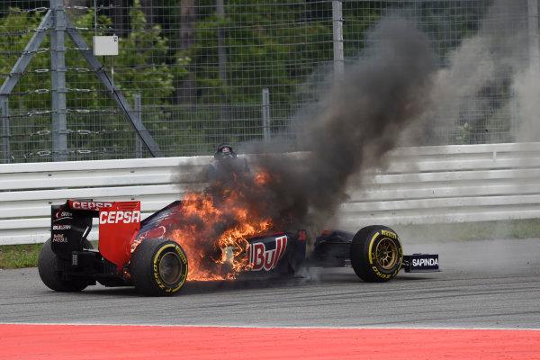 Hockenheimring, Hockenheim, Germany. Sunday 20 July 2014. Flames engulf the car of Daniil Kvyat, Toro Rosso STR9 Renault. World Copyright: Steve Etherington/LAT Photographic. ref: Digital Image GER-RACE-3083