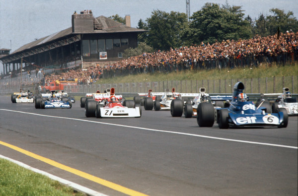 1973 German Grand Prix.  Nurburgring, Germany. 3-5th August 1973.  Fran?ois Cevert, Tyrrell 006 Ford, Carlos Reutemann, Brabham BT42 Ford, Jacky Ickx, McLaren M23 Ford, and Niki Lauda, BRM P160E, battle at the start.  Ref: 73GER21. World Copyright: LAT Photographic