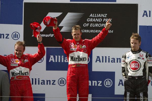 2004 European Grand Prix - Sunday Race,Nurburgring, Germany. 30th May 2004 Race podium - winner Michael Schumacher, Ferrari F2004, (1st) and team mate Rubens Barrichello, (2nd) and Jenson Button, BAR Honda 006, (3rd).World Copyright: Steve Etherington/LAT Photographic ref: Digital Image Only