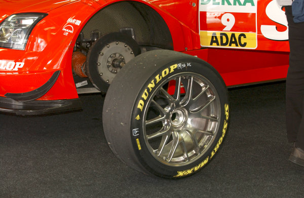 2004 DTM Championship Lausitzring. Germany. 4th - 6th june 2004. The front wheel, tyre and brakes on Heinz Harald Frentzen's OPC Holzer Opel Vectra GTS.World Copyright: Andre Irlmeier/LAT Photographic ref: Digital Image Only