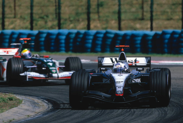 2004 Hungarian Grand Prix Hungaroring, Hungary. 13th - 15th August. David Coulthard, McLaren Mercedes MP4/19B leads Mark Webber, Jaguar R5. Action. World Copyright:PICME/LAT Photographic Ref:35mm Image:A14