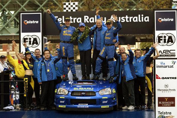 2003 FIA World Rally Champs. Round Ten Telstra Rally Australia 4th-7th September 2003.Petter Solberg, Subaru, Podium.World Copyright: McKlein/LAT