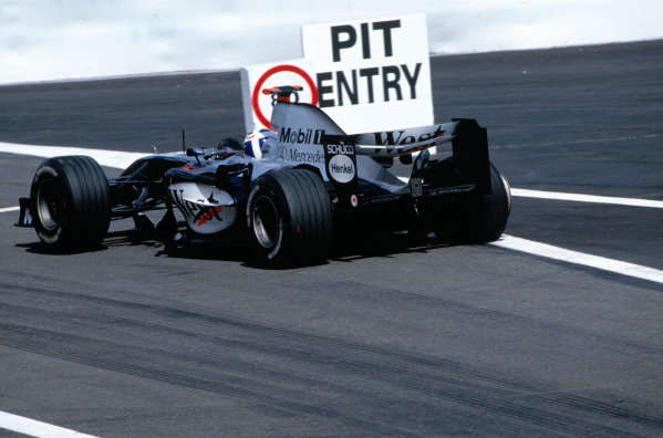 2004 Belgian Grand Prix.Spa Francorchamps, Belgium. 27th - 29th August.David Coulthard, McLaren Mercedes MP4/19B heads into thew pits after he has a rear right tyre failure. Action. World Copyright:LAT PhotographicRef:35mm Image A08