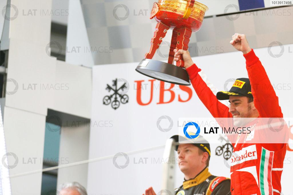 Shanghai International Circuit, Shanghai, China Sunday 14th April 2013 Fernando Alonso, Ferrari, 1st position, celebrates with his trophy on the podium. World Copyright: Alastair Staley/LAT Photographic ref: Digital Image _R6T2438