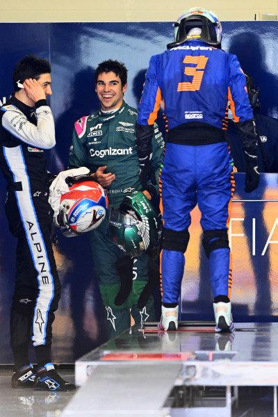 Esteban Ocon, Alpine F1, Lance Stroll, Aston Martin, and Daniel Ricciardo, McLaren, are weighed after the race