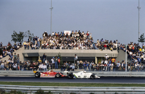 Alan Jones, Williams FW07 Ford leads Gilles Villeneuve, Ferrari 312T4.