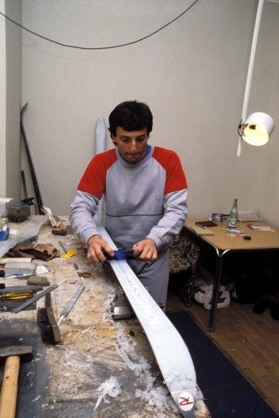 Sestriere, Italy. Riccardo Patrese prepares his skis before a race for Formula 1 drivers
