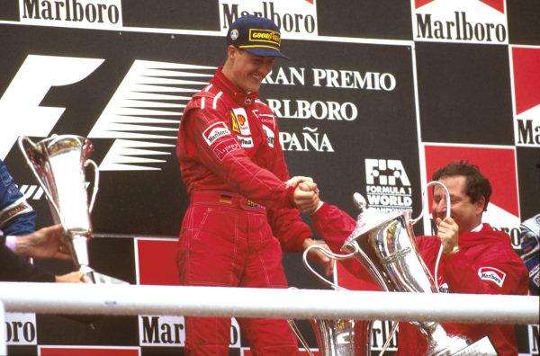 Catalunya, Barcelona, Spain.31/5-2/6 1996.Michael Schumacher (Ferrari) 1st position, celebrates on the podium with team boss Jean Todt.Ref-96 ESP 01.World Copyright - LAT Photographic