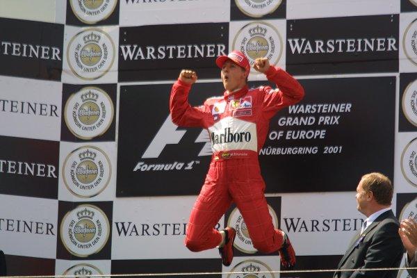 2001 European Grand Prix. RACENurburgring, Germany. 24th June 2001Race winnner Michael Schumacher, Ferrari F2001, leaps in the air - podium.World Copyright - LAT Photographicref: 8 9 MB Digital File Only
