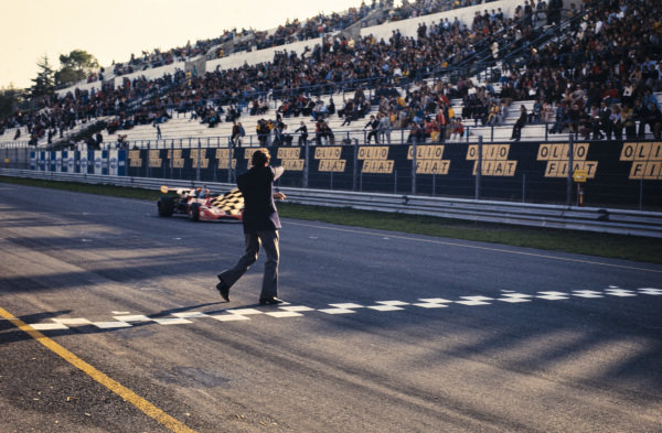 Jacques Coulon, March 732 BMW, crosses the finish line and takes the chequered flag.