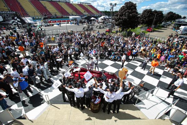 #55 Mazda Team Joest Mazda DPi, DPi: Jonathan Bomarito, Harry Tincknell, Olivier Pla, Celebrates with team in Gatorade Victory Lane