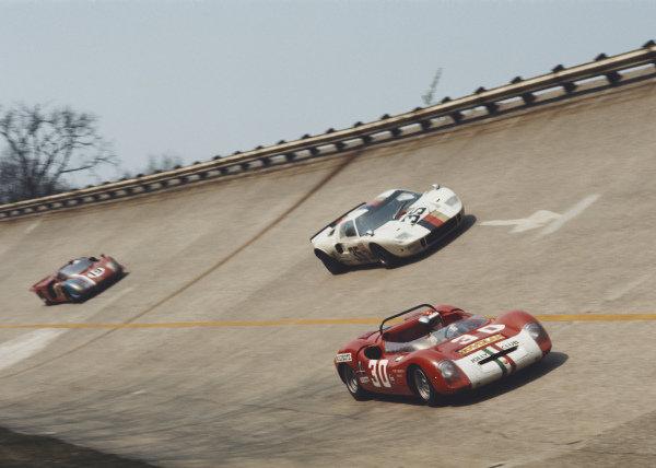 Ugo Locatelli / Maurizio Zanetti, Ugo Locatelli, Abarth 1000 SP SE4/0047, leads Helmut Kelleners / Reinhold Joest, IGFA Racing Team, Ford GT40 1081, and Teddy Pilette / Rob Slotemaker, Racing Team VDS, Alfa Romeo T33/2 2.5 75033-015.