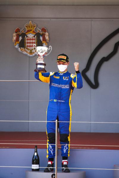 Felipe Drugovich (BRA, Uni-Virtuosi) celebrates on the podium with the trophy