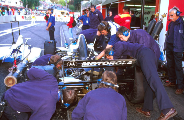Spa-Francorchamps, Belgium.23-25 August 1996.The Tyrrell mechanics get straight to work on their car. 