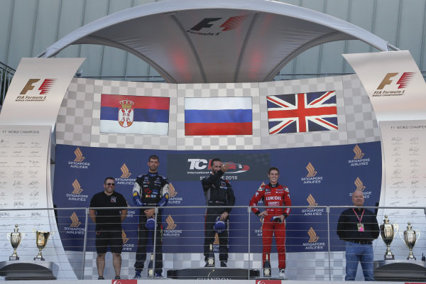 (L to R): Second placed Dusan Borkovic (SRB) B3 Racing Team, race winner Mikhail Grachev (RUS) WestCoast Racing and third placed at James Nash (GBR) Team Craft-Bamboo celebrate on the podium at TCR International Series, Rd9, Marina Bay Street Circuit, Singapore, 16-18 September 2016.