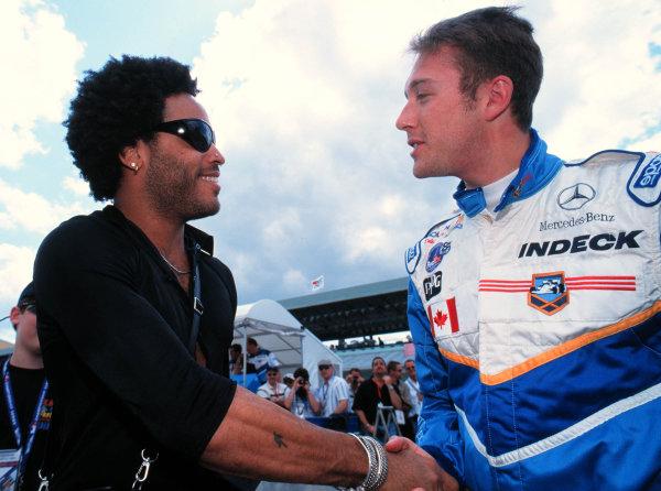 1999 CART MIAMI GP, 21-3-99, Homestead, FL, USAGreg Moore says hello to his friend & fan, rock star Lenny Kravitz. -1999, Michael L. Levitt, LAT Photographic