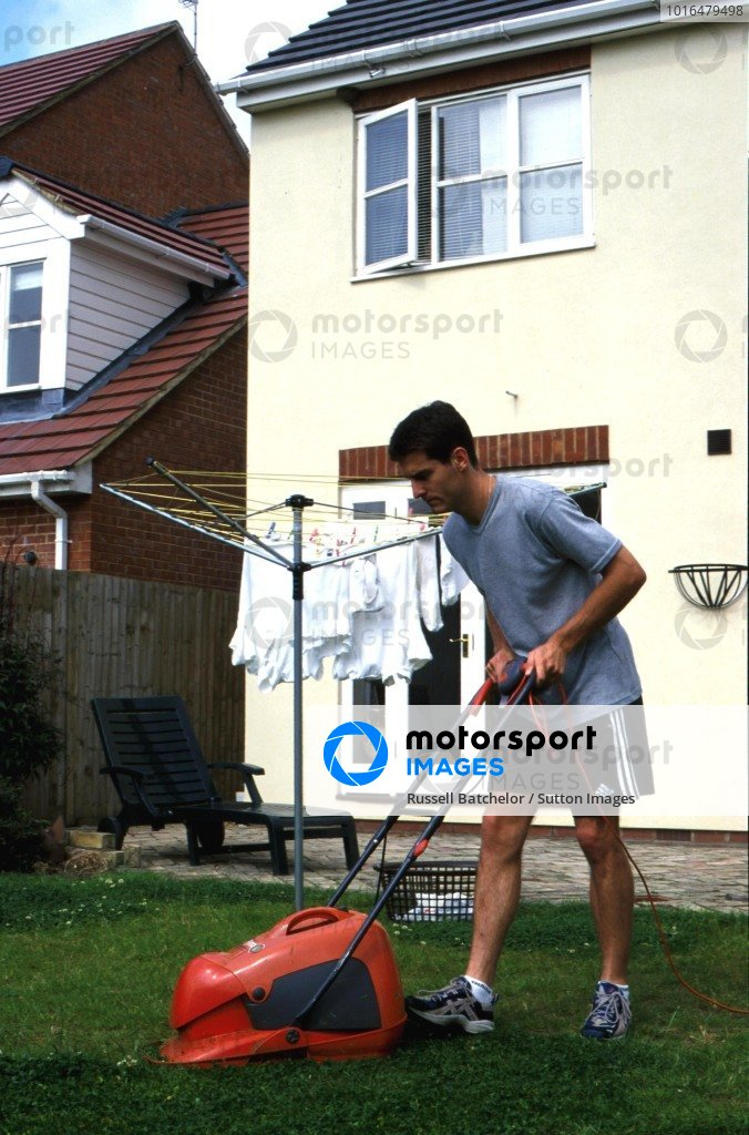 Mark Webber (AUS) at home in England owing the lawn. 16 July 2000 BEST IMAGE