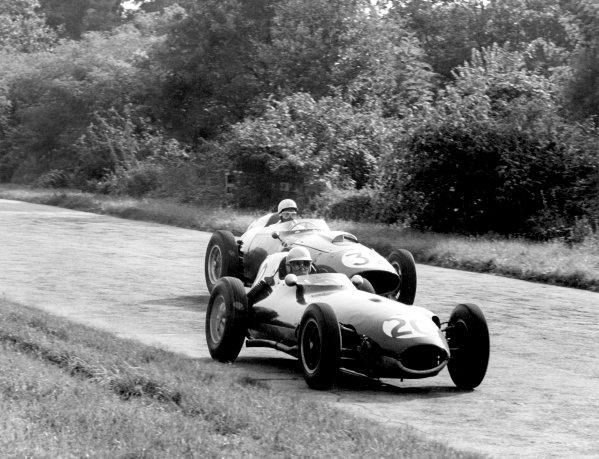 1959 Italian Grand Prix.Monza, Italy. 13 September 1959.Innes Ireland (Lotus 16-Climax) leads Phil Hill (Ferrari Dino 246). Ref-B&W Print, 40mb RGB scan.World Copyright: LAT Photographic